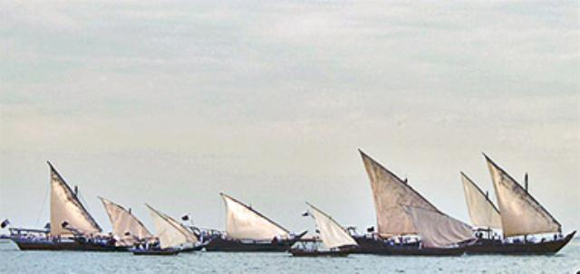 TRADITIONAL BOATS IN PERSIAN GOLF.This photograph shows a fleet of traditional craft with their lateen sails raised on the occasion of National Day 2009 in Doha s West Bay. They are a beautiful sight. The traditional boats of the Gulf are obviously neither Islamic in any way nor are they elements of Gulf architecture. However, they seem to me to have so much in common with traditional Gulf architecture and the way of life prior to development irrevocably changed the life of Qataris. In this sense I see boats being as important as the traditional architecture, and I feel that they should be looked at in parallel with land-based architecture. Regata tradicionalnih brodova na latinsko idro u Perzijskom Zalivu.